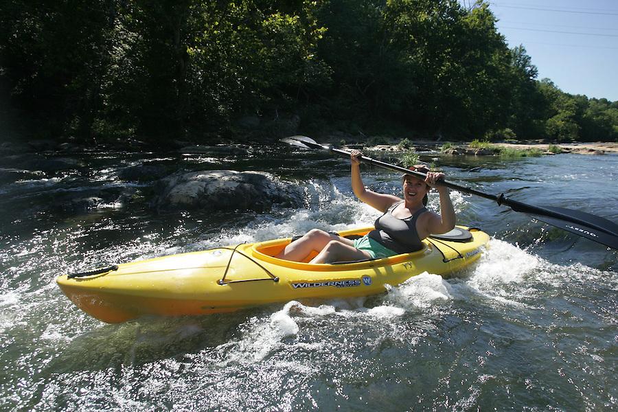 Kayaking in Rivanna River located in Charlottesville, VA. Photo/Andrew Shurtleff