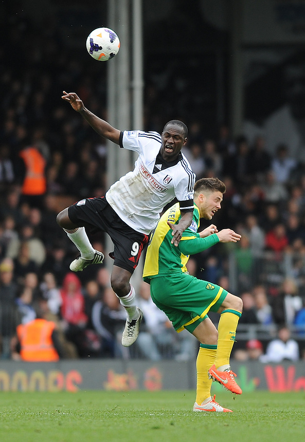 Mahamadou Diarra battles with Norwich City's Ricky van Wolfswinkel<br /> <br /> Photo by Ashley Western/CameraSport<br /> <br /> Football - Barclays Premiership - Fulham v Norwich City - Saturday 12th April 2014 - Craven Cottage - London<br /> <br /> &copy; CameraSport - 43 Linden Ave. Countesthorpe. Leicester. England. LE8 5PG - Tel: +44 (0) 116 277 4147 - admin@camerasport.com - www.camerasport.com