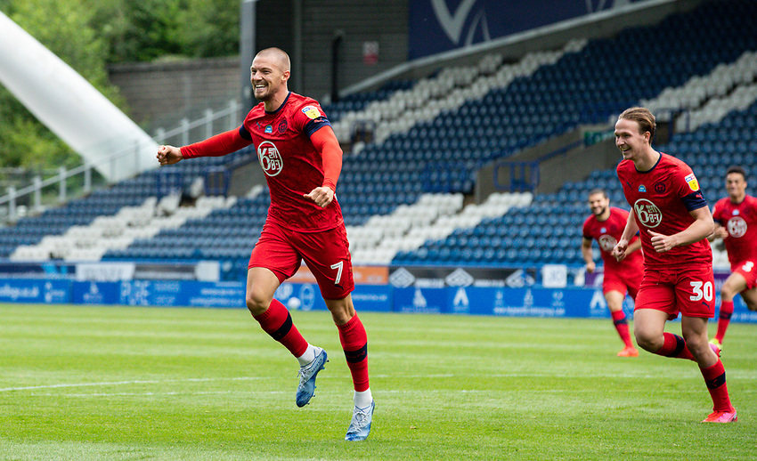 Wigan Athletic's Anthony Pilkington celebrates scoring his side's second goal<br /> <br /> Photographer Alex Dodd/CameraSport<br /> <br /> The EFL Sky Bet Championship - Huddersfield Town v Wigan Athletic - Saturday 20th June 2020 - John Smith's Stadium - Huddersfield <br /> <br /> World Copyright © 2020 CameraSport. All rights reserved. 43 Linden Ave. Countesthorpe. Leicester. England. LE8 5PG - Tel: +44 (0) 116 277 4147 - admin@camerasport.com - www.camerasport.com
