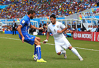 Luis Suarez of Uruguay nutmegs Andrea Barzagli of Italy