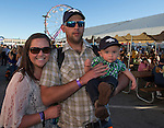 Linzy, Mike and 8-month-old Chase Simons during Wolf Pack Night at the Reno Rodeo on Wednesday, June 22, 2016.