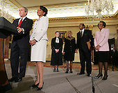"US President George W. Bush, with Secretary Rice's Aunt Genoa ""Gee""McPhatter(R), Uncle Alto Ray(2R), Aunt Mattie Bonds(3R) and Supreme Court Justice Ruth Bader Ginsberg(3L) introduces Secretary of State Condoleezza Rice during a swearing in ceremony in the Benjamin Franklin Room of the Department of State in Washington, DC Friday 28 January 2005. Secretary Rice, who is the second woman and the first black woman to become Secretary of State, was sworn in by White House chief of staff Andrew Card Wednesday evening, hours after the Senate confirmed her by a vote of 85 to 13,  in a private ceremony at the White House.<br /> Credit: Shawn Thew / Pool via CNP"