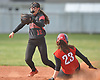 Ashley D'Antuono #23, Island Trees left fielder, slides safely into second base as Plainedge shortstop Jackie Mahlmeister #12 covers in the top of the second inning of a Nassau County varsity softball game at Schwarting Elementary School in North Massapequa on Monday, May 1, 2017. Plainedge won by a score of 10-5.