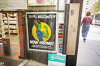 A Ricky's cosmetics store in New York advertises that it is hiring workers for Halloween in a sign on the door, seen on Saturday, September 3, 2016. The chain, besides having a large choice of health and beauty aids is known for its pop-up Halloween stores.   (© Richard B. Levine)