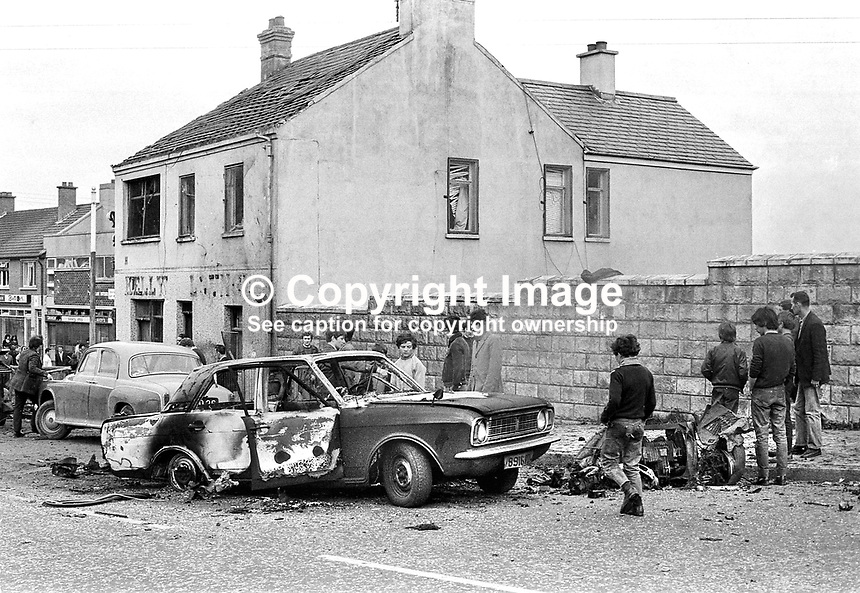 Explosion at Kelly's Bar at the junction of Springfield and Whiterock Roads, Belfast on 13th May 1972. It was carried out by Loyalists.  Over 60 people were injured, 7 seriously. One of seriously injured, a 19 year old part time barman working in the pub, John Moran, died subsequently on 23 May. The explosion sparked off a 3-way gun battle between the British Army, the Provisional IRA and the UVF (Ulster Volunteer Force) in which 4 people died on the day of the explosion, and 2 the following day.  Ref: 19720513001 <br />