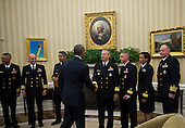 United States President Barack Obama shakes hands with Rear Admiral Boris Lushniak Officer-in-Charge of MMU Transition Between Teams, after meeting with members of the Public Health Service Commissioned Corps (PHS CC) after signing a citation awarding the Presidential Unit Citation to PHS CC members who participated in the Ebola containment efforts in West Africa, in the Oval Office at The White House in Washington, D.C., U.S., on Thursday, Sept. 24, 2015.<br /> Credit: Rod Lamkey Jr. / Pool via CNP
