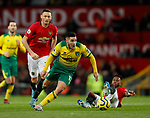 Emi Buendia of Norwich City skips over ta tackle by Fred of Manchester United ring the Premier League match at Old Trafford, Manchester. Picture date: 11th January 2020. Picture credit should read: James Wilson/Sportimage