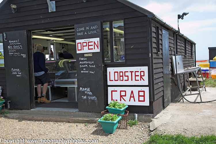 Fresh fish on sale from wooden shed by the beach, Aldeburgh, Suffolk, England
