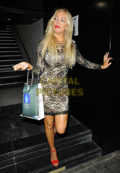 Aisleyne Horgan Wallace<br /> The Bloggers Love Collection fashion show, The Penthouse, London, England. August 22nd, 2013<br /> full length red sandals shoes black lace dress  goody bag<br /> CAP/CAN<br /> &copy;Can Nguyen/Capital Pictures