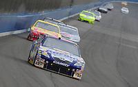 Oct. 11, 2009; Fontana, CA, USA; NASCAR Sprint Cup Series driver David Reutimann during the Pepsi 500 at Auto Club Speedway. Mandatory Credit: Mark J. Rebilas-