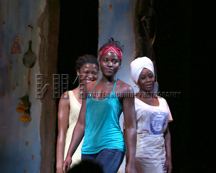 Lupita Nyong'o, Pascale Armand, and Akosua Busia onstage during the 'Eclipsed' broadway opening night curtain call at The Golden Theatre on March 6, 2016 in New York City.