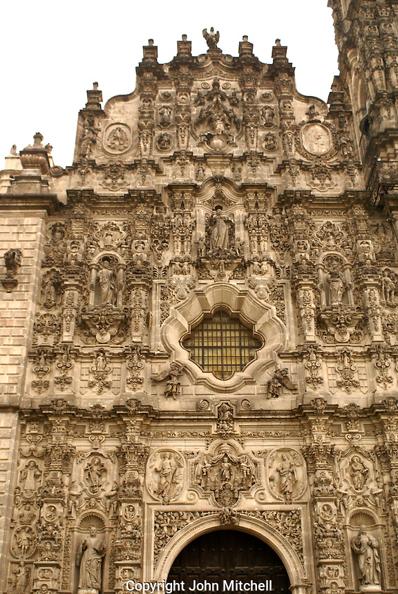 The baroque facade of the 17th century Iglesia de San Francisco in Tepotzotlan, Mexico.  The San Francisco Javier Church and adjoining former Jesuit monastery now house the National Museum of the Viceroyalty or Museo Nacional de Virreinato.