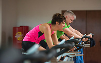 NWA Democrat-Gazette/BEN GOFF @NWABENGOFF<br /> Brandi Holt of Fayetteville bikes Saturday, March 10, 2018, while competing in the 2018 Indoor Triathlon at the Jones Center in Springdale. Participants started in waves and had 10 minutes to swim, 20 minutes on a stationary bike and 15 minutes on a treadmill to log as many miles as possible.