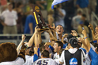 UCLA Bruins celebrate with the National Championship trophy following the 2013 Men's College World Series Final on June 25, 2013 at TD Ameritrade Park in Omaha, Nebraska. The Bruins defeated the Bulldogs 8-0, winning the National Championship. (Andrew Woolley/Four Seam Images)