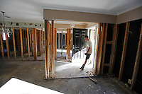 John Ward walks into his grandma's (Barbara Earl's) gutted home on Todd Preis Drive in the Nashville suburb of Bellevue on Saturday, May 8, 2010.