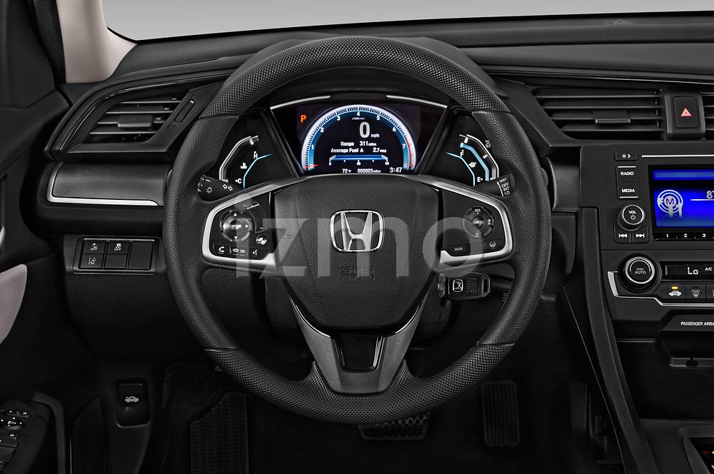 Car pictures of steering wheel view of a 2019 Honda honda LX 4 Door Sedan