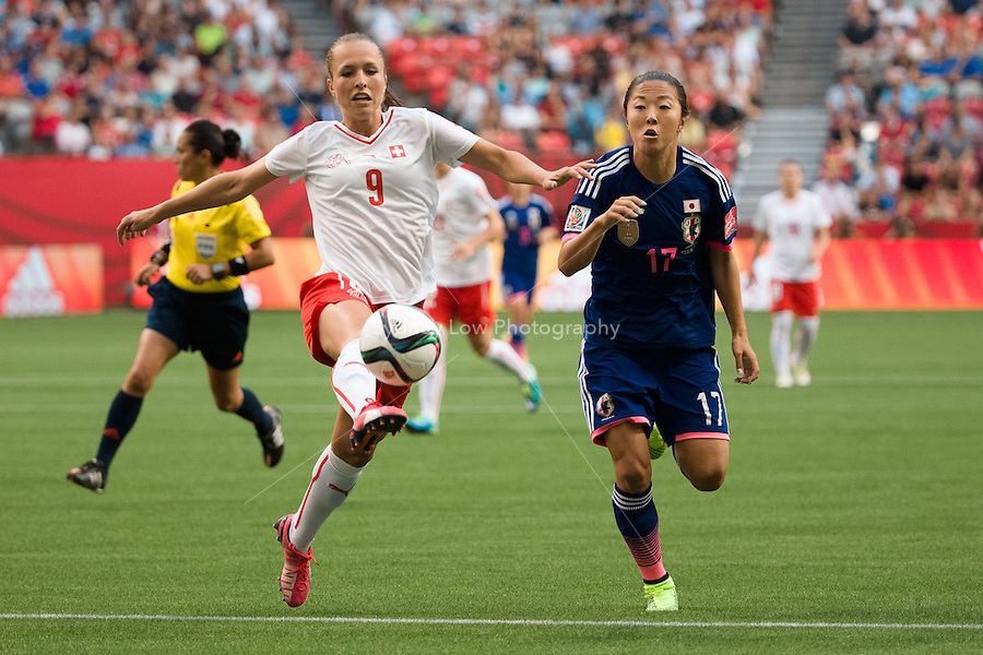 June 8, 2015: Lia WAELTI of Switzerland kicks the ball during a Group C match at the FIFA Women's World Cup Canada 2015 between Japan and Switzerland at BC Place Stadium on 8 June 2015 in Vancouver, Canada. Sydney Low/AsteriskImages