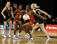 31.10.2013 Silver Fern Shannon Francois and Malawi's Melenia Gideon in action during the Silver Ferns V Malawi during the New World Netball Series played at the Claudelands Arena in Hamilton. Mandatory Photo Credit ©Michael Bradley.