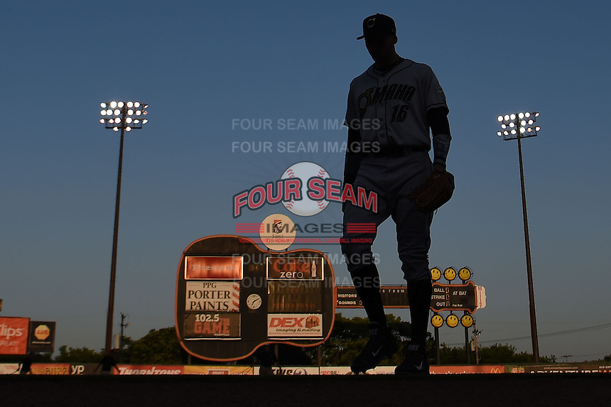 Omaha Storm Chasers player walks into the dugout during the first game of a double header against the Nashville Sounds on May 21, 2014 at Herschel Greer Stadium in Nashville, Tennessee.  Nashville defeated Omaha 5-4.  (Mike Janes/Four Seam Images)