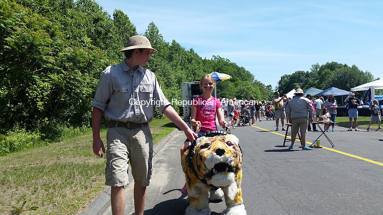 OXFORD, CT-JUNE 07, 2015-060815_NEW_060715NS02-Cate Wickenheisser, Oxford, enjoys a tiger ride from Safari Rides, Photos and Special events at the First Annual Oxford Food and Arts Festival, Sunday. <br /> Nicholas Shigo/Republican American.