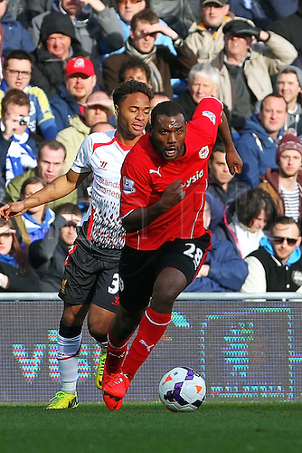 22.03.2014  Cardiff, Wales. Théophile-Catherine breaks away from Zaha during the Premier League game between Cardiff City and Liverpool from Cardiff City Stadium.