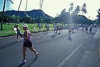Runners passing Diamond Head in Kapiolani Park at the Honolulu Marathon