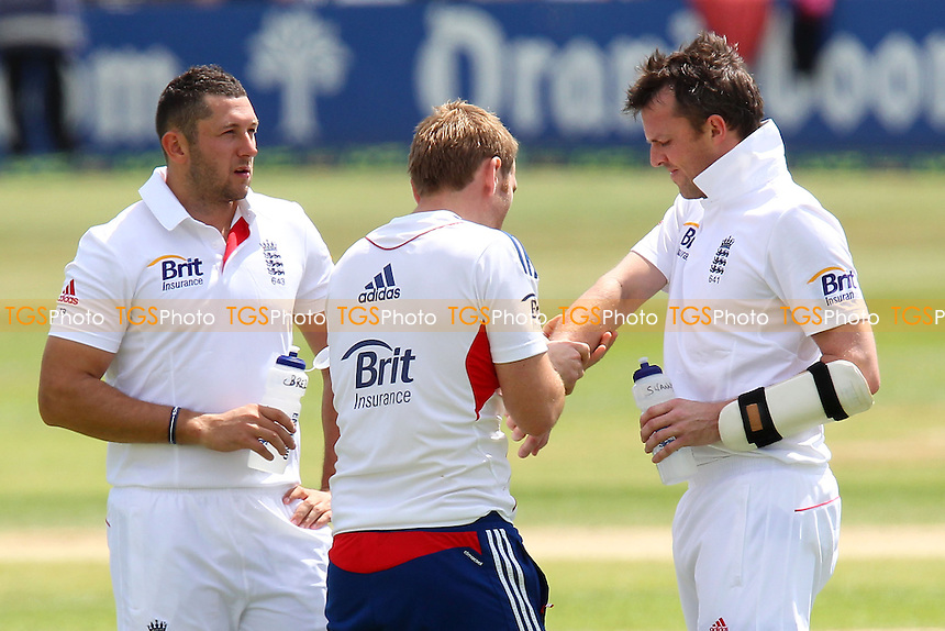 Graeme Swann (R) of England receives treatment for an arm injury - Essex CCC vs England - LV Challenge Match at the Essex County Ground, Chelmsford - 01/07/13 - MANDATORY CREDIT: Gavin Ellis/TGSPHOTO - Self billing applies where appropriate - 0845 094 6026 - contact@tgsphoto.co.uk - NO UNPAID USE