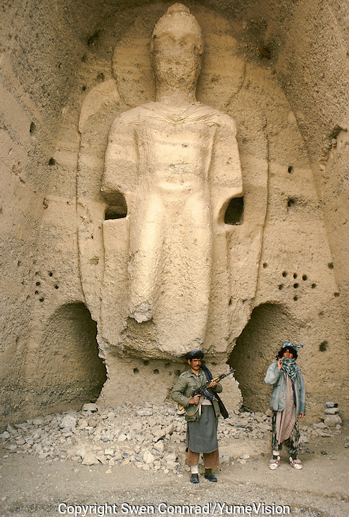 Two Hazara Mujahedin's at the Kakrak  Buddha 6 meters statue in 1996. In the Kakrak Valley, 2 kilometres south of the giant Bamiyan Buddha cliff , there is a 6 meters standing Buddha in a niche which was discovered in 1930. The Buddha niche is also surrounded by caves but the paintings were painstakingly removed by French archaeologists.Some scholars consider these mystic diagrams from Kakrak to be the earliest specimens of the type of cosmic Mandala found today in Nepal and Tibet.