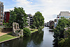 New housing developments on bank of River Wensum, Norwich UK 2017. On site of old Colman factory. Remains of city walls in foreground, Norwich UK 2017. On right, site of old Colman factory. Remains of city walls in foreground