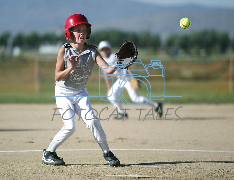 Recreational girls softball action in Gardnerville, Nev., on June 11, 2003..Photo by Cathleen Allison