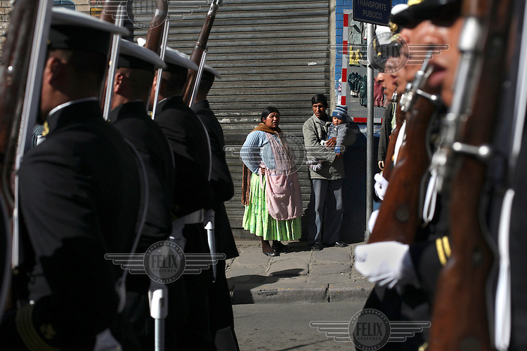 Women watch as Bolivian Navy soldiers march to mourn the day they lost their ocean to Chile in the War of the Pacific. Bolivia lost what is now northern Chile in a war over nitrates leaving Bolivia without access to the ocean.