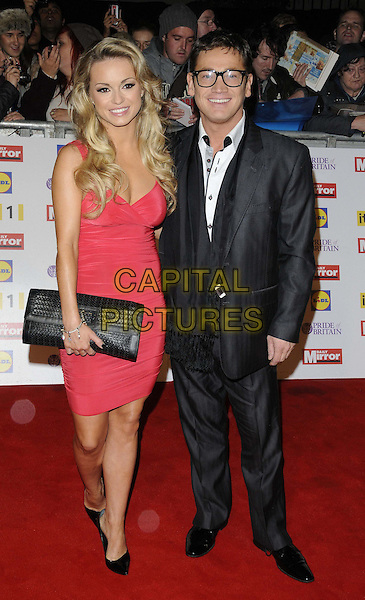 Ola Jordan & Sid Owen.Pride Of Britain Awards at Grosvenor House, London, England..29th October 2012.full length black red pink dress clutch bag suit glasses .CAP/CAN.©Can Nguyen/Capital Pictures.
