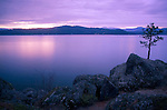 Idaho, North, Coeur d'Alene. Pink evening light  reflects in the calm water of  Lake Coeur d'Alene at twilight.