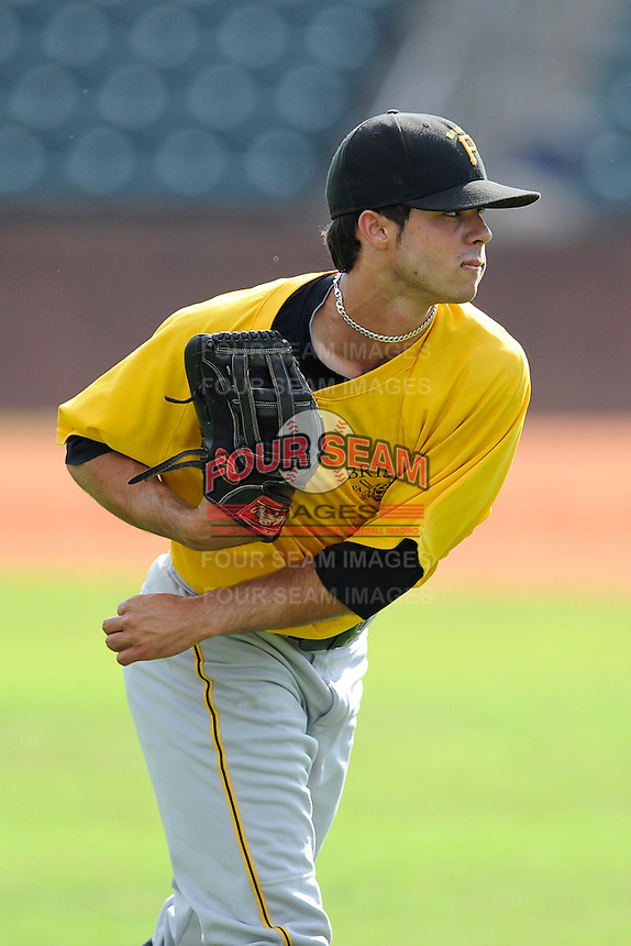 Center fielder Eduardo Figueroa (13) of the Bristol Pirates warms up before a game against the Greeneville Astros on Friday, July 25, 2014, at Pioneer Park in Greeneville, Tennessee. Greeneville won, 9-4. (Tom Priddy/Four Seam Images)