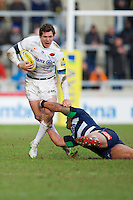 21.02.2015.  Sale, England.  Aviva Premiership Rugby. Sale Sharks versus Saracens. Saracens fullback Alex Goode is tackled by Sale Sharks centre Sam Tuitupou.