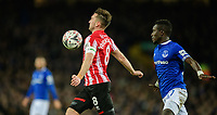 Lincoln City's Lee Frecklington shields the ball from Everton's Idrissa Gueye<br /> <br /> Photographer Chris Vaughan/CameraSport<br /> <br /> Emirates FA Cup Third Round - Everton v Lincoln City - Saturday 5th January 2019 - Goodison Park - Liverpool<br />  <br /> World Copyright &copy; 2019 CameraSport. All rights reserved. 43 Linden Ave. Countesthorpe. Leicester. England. LE8 5PG - Tel: +44 (0) 116 277 4147 - admin@camerasport.com - www.camerasport.com