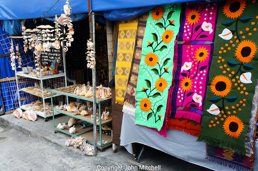 Sea shells and colorful table runners in the Mercado 28 souvenirs and handicrafts market in  Cancun, Mexico      .