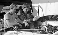 Neil Bonnet, right, looks at the engine of his race car,   Atlanta Journal 500, Atlanta Motor Speedway, Hampton, Georgia, November 6, 1983.  (Photo by Brian Cleary/www.bcpix.com)