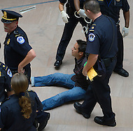 October 6, 2011  (Washington, DC)  U.S. Capitol Police arrest a man as he protested at the Hart senate office building.  He was one of five people to be arrested for protesting the United States on-going war efforts.  The demonstration was organized by the October 2011 group and Veterans For Peace.  (Photo by Don Baxter/Media Images International)