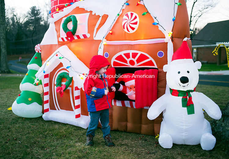 Harwinton, CT- 05 December 2015-120515CM07-  Ronan O'Leary 3 of Burlington plays outside an inflatable Christmas village during the Harwinton Hometown Holiday Celebration on Saturday.      Christopher Massa Republican-American