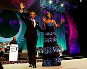 United States President Barack Obama and first lady Michelle Obama arrive on stage before the President delivers remarks at the Congressional Black Caucus Foundation's 45th Annual Phoenix Awards Gala at the Walter E. Washington Convention Center, September19, 2015 in Washington, DC. <br /> Credit: Aude Guerrucci / Pool via CNP