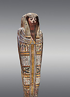 """Ancient Egyptian wooden sarcophagus - the tomb of Tagiaset, Iuefdi & Harwa circa 22nd Dynasty (943 - 716 BC.) Thebes. Egyptian Museum, Turin. Grey background.<br /> <br /> Coffin lid of the eldest woman buried in the tomb, probably Tagiasettahekat, wife of Padiau. The sarcophagus decoration includes representation of strips crossed over her chest typical of """"stoa coffin"""" of the 22nd dynasty."""