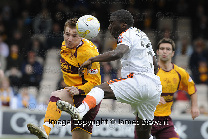 26/04/2008   Collect Pic: James Stewart.File Name : sct_jspa05_motherwell_v_dundee_utd.ROSS MCCORMACK HEADS CLEAR FROM MORGARO GOMIS.James Stewart Photo Agency 19 Carronlea Drive, Falkirk. FK2 8DN      Vat Reg No. 607 6932 25.Studio      : +44 (0)1324 611191 .Mobile      : +44 (0)7721 416997.E-mail  :  jim@jspa.co.uk.If you require further information then contact Jim Stewart on any of the numbers above........