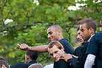 Darren Pratley gives a thumbs up with Swansea City Football Club players and staff celebrating their promotion to the Premier League with an opentop bus tour of the city, where thousands of supporters turned out to show their appreciation..