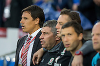Wales manager Chris Coleman and his staff sing the Wales national anthem ahead of the FIFA World Cup Qualifier match between Wales and Moldova at Cardiff City Stadium, Cardiff, Wales on 5 September 2016. Photo by Mark  Hawkins.