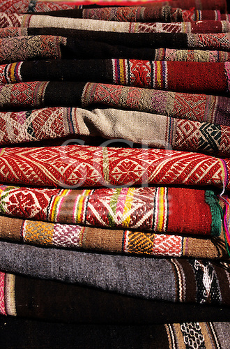 Ollantaytanbo, Peru. Pile of traditional woven mantas.