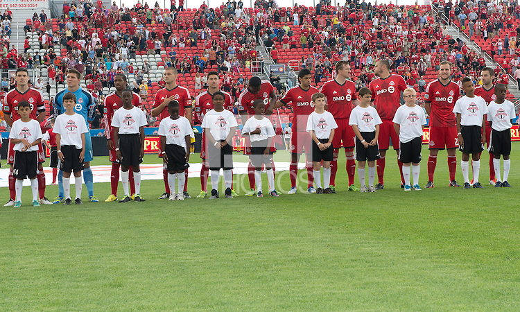 29 June 2013: Toronto FC players participate<br /> during the opening ceremonies in an MLS game between Real Salt Lake and Toronto FC at BMO Field in Toronto, Ontario Canada.<br /> Real Salt Lake won 1-0.