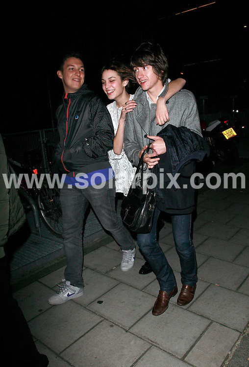 **ALL ROUND PICTURES FROM SOLARPIX.COM**.*WORLDWIDE RIGHTS*.Celebrities leaving the West Rocks presented by Tara Rocks, Shepherds Bar, Shepherds Bush, London..This Pic:Alex Turner (Arctic Monkey) leaves with Alexa Chung, Matt Helders and a friend.JOB REF: 5259   GMT   DATE: 02.11.07.**MUST CREDIT SOLARPIX.COM OR DOUBLE FEE WILL BE CHARGED* *UNDER NO CIRCUMSTANCES IS THIS IMAGE TO BE REPRODUCED FOR ANY ONLINE EDITION WITHOUT PRIOR PERMISSION*