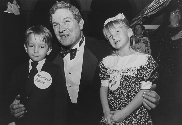 Sen. Kit Bond, R-Mo., with twin March of Dimes Ambassadors Neil and Jacquelyn Burch at Gourmet Gala night, on March 22, 1994. (Photo by Maureen Keating/CQ Roll Call via Getty Images)