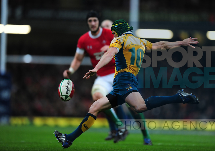 Matt Giteau of Australia clears the ball